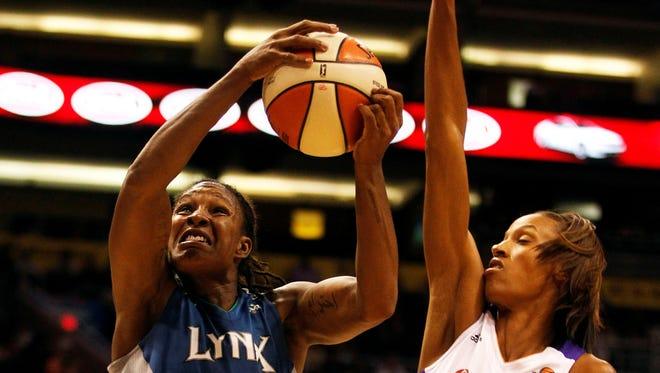 Minnesota Lynx forward Rebekkah Brunson (32) shoots against Phoenix Mercury forward DeWanna Bonner (24) during the second half of a basketball game at US Airways Center.