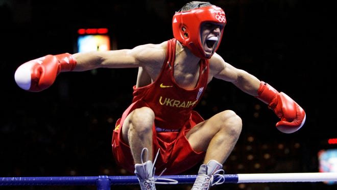 Vasyl Lomachenko, who won two Olympic gold medals for Ukraine, signed to go pro with Top Rank