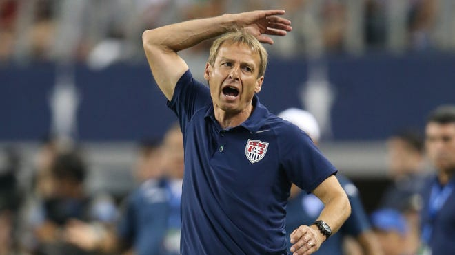 U.S. coach Jurgen Klinsmann reacts to play on the field against Honduras at Cowboys Stadium. Klinsmann was thrown out of the game for this reaction and won't coach in the Gold Cup Final.