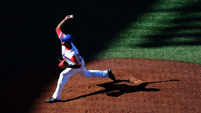 Miguel Alfredo Gonzalez pitches during the bronze medal match between Mexico and Cuba during the XVI Pan American Games.