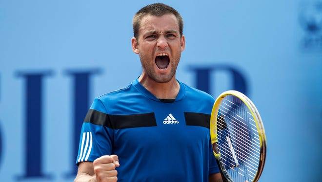 Mikhail Youzhny reacts during a semifinal match against Victor Hanescu at the Swiss Open in Gstaad, Switzerland.