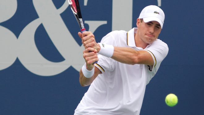 John Isner returns a shot to Lleyton Hewitt during the semifinals of the BB&T Atlanta Open.