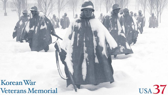 The U.S. Postal Service in 2003 issued a stamp showing the statues of the Korean War Veterans Memorial shrouded in heavy snow reminiscent of winter fighting in Korea. The memorial features 19 stainless-steel statues that depict American troops in the Army, Marines, Navy and Air Force marching in a wedge formation as if on patrol. The memorial is on the National Mall in Washington, D.C.