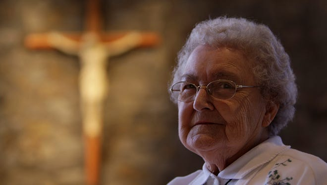 Sister Joan Krimm, 83, in the chapel at the Sisters of Notre Dame de Namur in Reading, Ohio. The Enquirer/Glenn Hartong.
