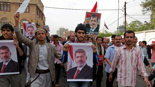 Supporters of Egypt's ousted president Mohamed Morsi protest in Sanaa, Yemen on Sunday.