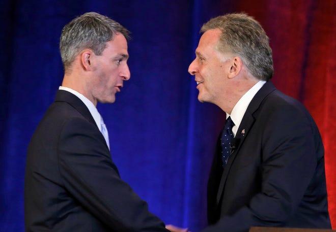 Republican gubernatorial candidate Ken Cuccinelli, left, greets Democratic challenger Terry McCauliffe at their debate July 20 in Hot Springs, Va.