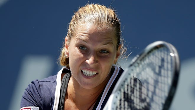 Dominika Cibulkova of Slovakia lines up a backhand during her victory against Agnieszka Radwanska of Poland during the final of the Bank of the West Classic.