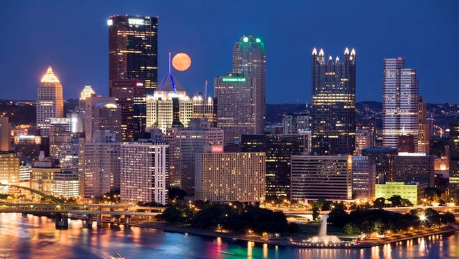 """The Pittsburgh skyline today. The city has enjoyed a resurgence in recent years, from being described once as """"hell with the lid off"""" to becoming a national leader in green buildings, a hub for clean energy businesses and an emerging tourist destination."""