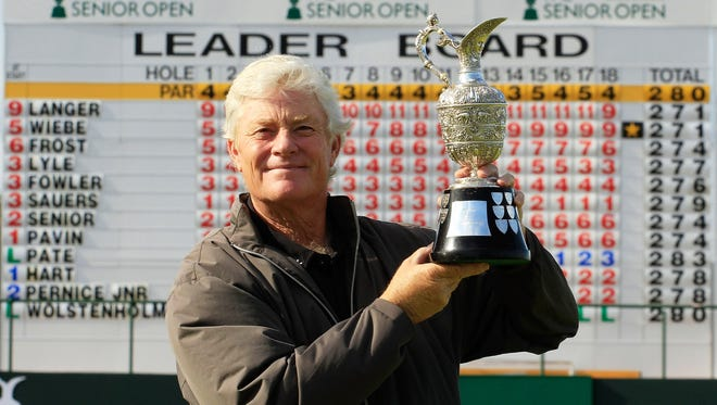 Mark Wiebe of the United States poses with the trophy after winning the playoff against Bernhard Langer of Germany.