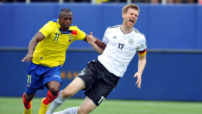 Ecuador's Christian Benitez (11) battles for control of the ball with Germany's Per Mertesacker (17) and during the first half in Boca Raton, Fla., on May 29.