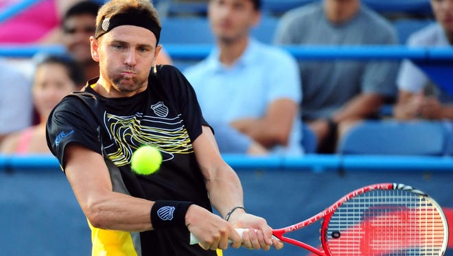 Mardy Fish hits a backhand shot to Matthew Ebden during the Citi Open at the William H.G. FitzGerald Tennis Center.