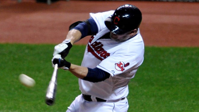 Cleveland Indians pinch hitter Jason Giambi hits a game-winning home run in the ninth inning against the Chicago White Sox at Progressive Field.