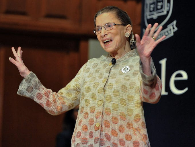 Justice Ginsburg waves to the audience during a speaking engagement at Yale University on Oct. 19, 2012, in New Haven, Conn.