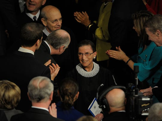 Justice Ginsburg enters the House of Representatives chamber before President Obama addresses a joint session of Congress on Feb. 24, 2009, at the U.S. Capitol in Washington.