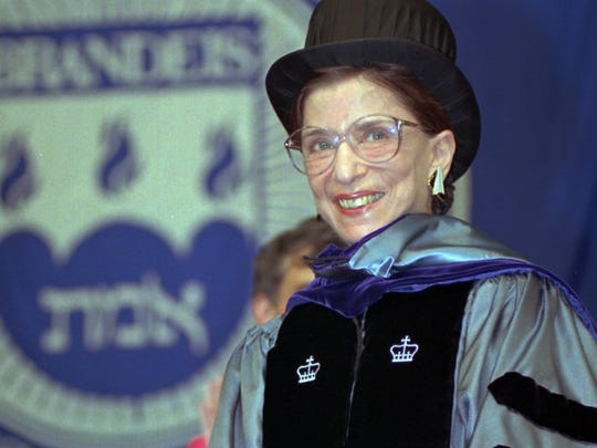 A smiling U.S. Supreme Court Justice Ruth Bader Ginsburg stands acknowledging the applause of the audience at the 45th commencement at Brandeis University in Waltham, Mass.,Sunday, May 19, 1996. Justice Ginsburg was honored with an honorary doctor of laws degree from the university. (AP Photo/C.J. Gunther) ORG XMIT: BX103