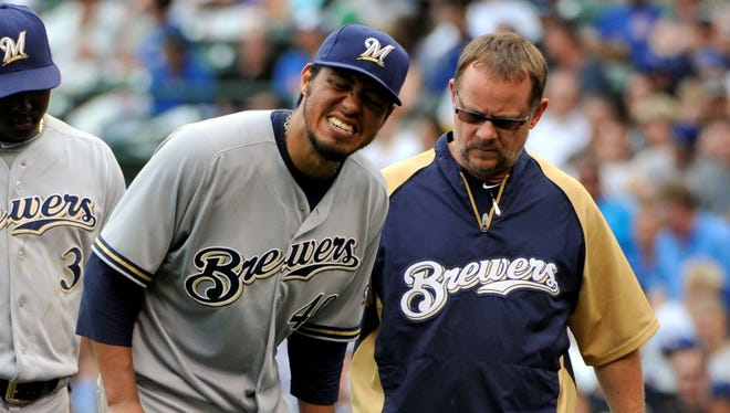 Yovani Gallardo left Tuesday's game against the Cubs because of tightness in his left hamstring.