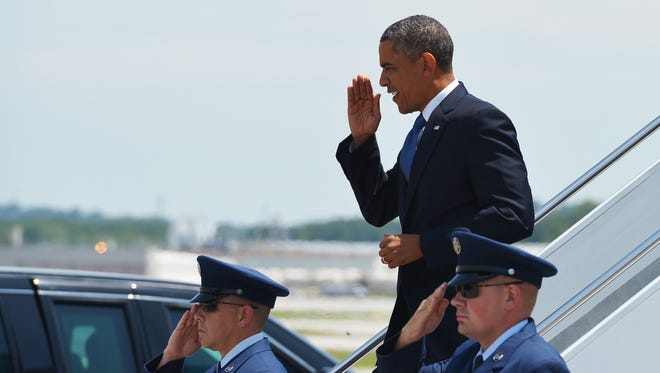 President Obama steps off Air Force One upon arrival Tuesday in Chattanooga, Tenn., where he gave a speech about the economy.