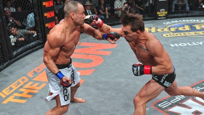 Michael Chandler, right, won the lightweight title from Eddie Alvarez in November 2011