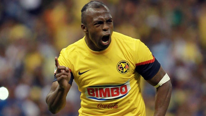 Christian Benitez celebrates after scoring against Queretaro during a Mexican soccer league match.