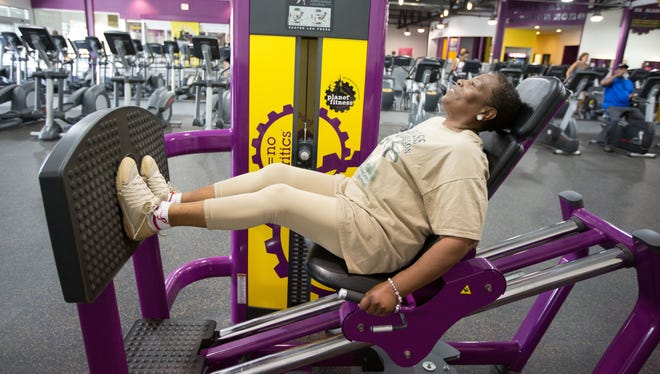 Vickie Powell-Bass, 60, does leg exercises during her morning workout in Chicago. She has peripheral artery disease.