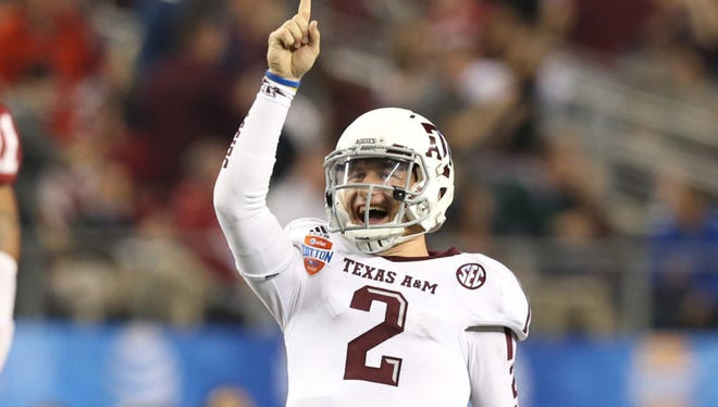 Jan 4, 2013; Arlington, TX, USA; Texas A&M Aggies quarterback Johnny Manziel (2) celebrates a touchdown in the third quarter against the Oklahoma Sooners during the Cotton Bowl at Cowboys Stadium.  Mandatory Credit: Tim Heitman-USA TODAY Sports ORG XMIT: USATSI-119044 ORIG FILE ID:  20130104_kkt_sh2_198.jpg