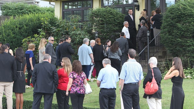 Mourners arrive for a wake for Lindsey Stewart at Wyman-Fisher Funeral Home in Pearl River, N.Y., on July 31, 2013. Stewart was killed in a boat crash in the Hudson River on Friday, July 26, 2013.