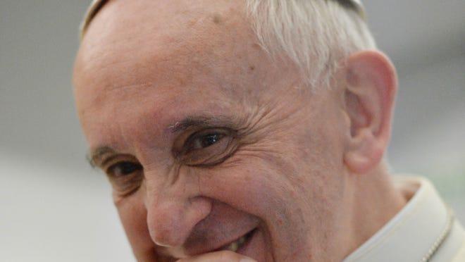Pope Francis aboard the papal flight leaving Brazil on Sunday.