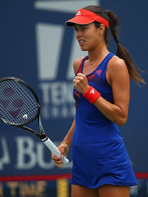 Ana Ivanovic celebrates a point during her first-round victory.
