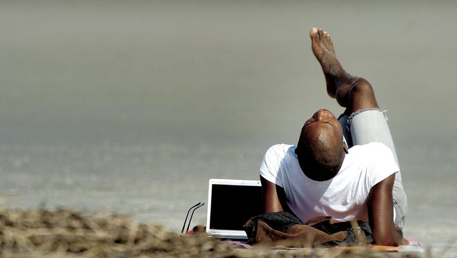 You are allowed to soak up the rays and do some stretching at the beach. Do you really need that laptop or tablet.