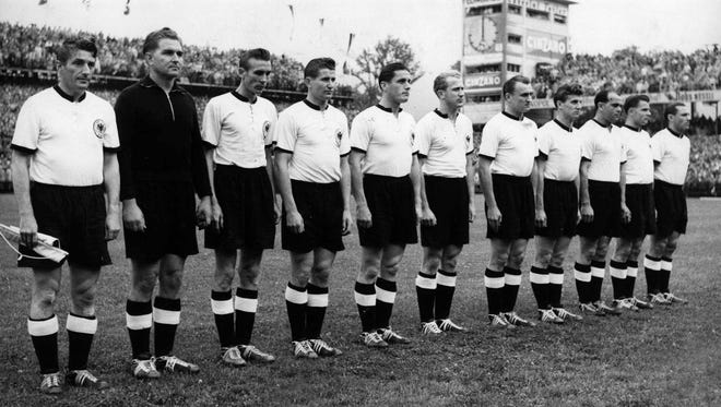 In this July 4, 1954, photo, West Germany players pose before the start of the World Cup final soccer match against Hungary in Berne, Switzerland.