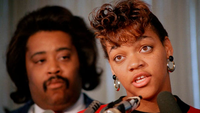 In this Oct. 8, 1988, file photo, Tawana Brawley speaks to reporters with her adviser, the Rev. Al Sharpton, in Chicago.