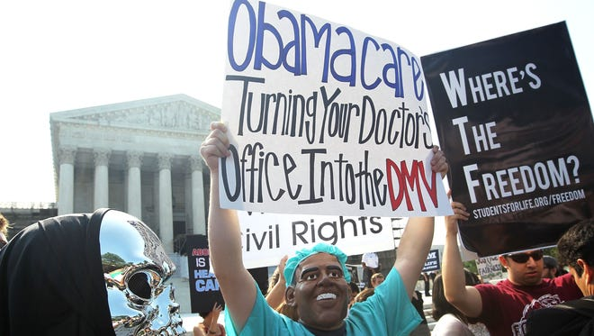 Anti-ObamaCare protesters at the Supreme Court in June 2012.