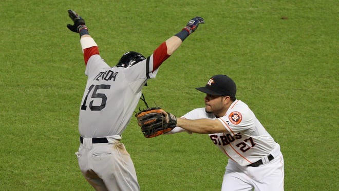 Boston Red Sox's Dustin Pedroia, left, is tagged out by Houston Astros second baseman Jose Altuve during the sixth inning in Houston.