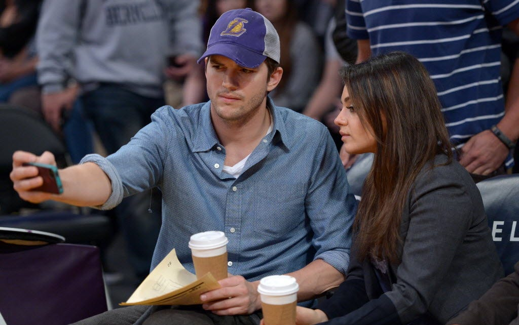 Selfie alert! The two document a moment at an NBA game in Los Angeles on Jan. 3.