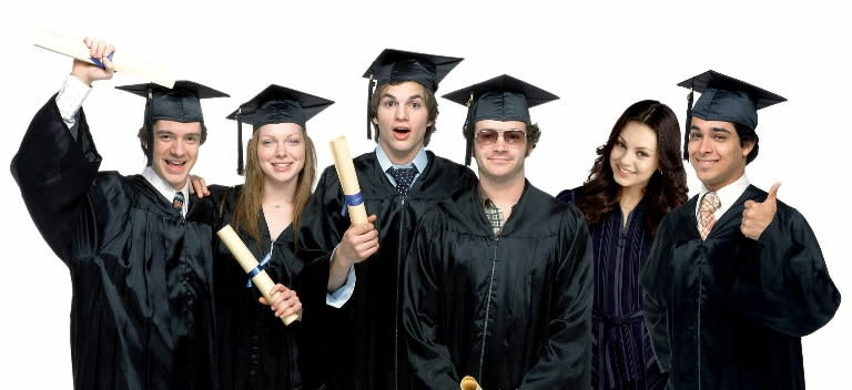 Topher Grace, left, Laura Prepon, Kutcher, Masterson, Kunis and Wilmer Valderrama get ready for high-school graduation on 'That '70s Show.'