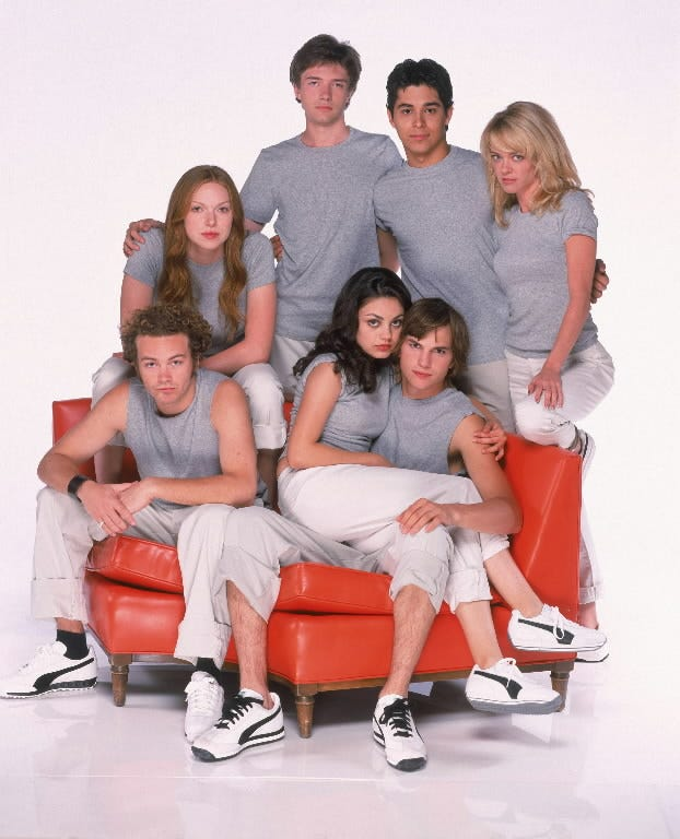 'That '70s Show' cast, clockwise from top: Topher Grace, Wilmer Valderrama, Lisa Robin Kelly, Kutcher, Kunis, Danny Masterson and Laura Prepon.