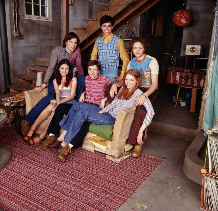 In 1998, clockwise from top: Valderrama, Masterson, Prepon, Grace, Kunis and Kutcher in a promotional still for Fox's 'That '70s Show.'
