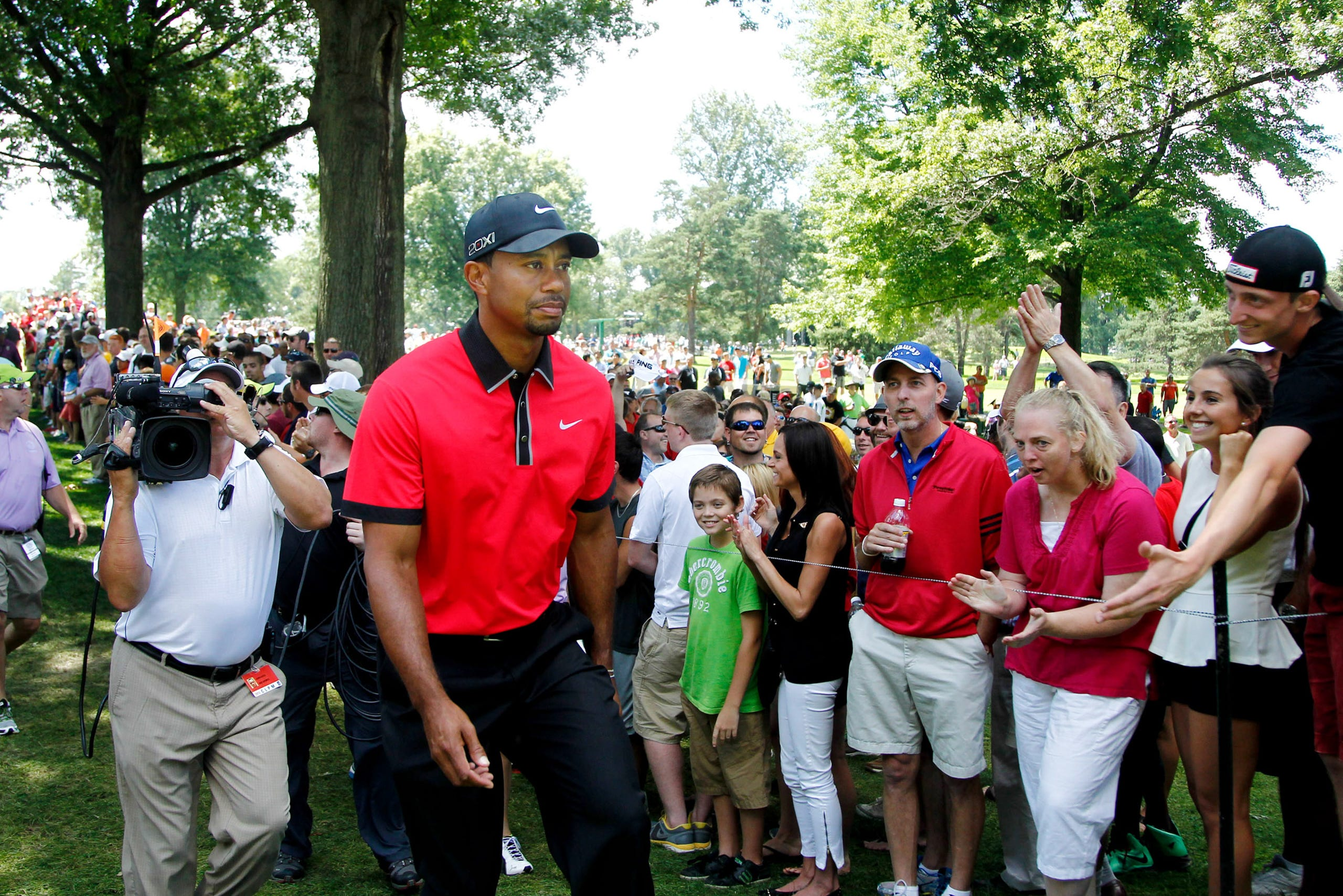 During the final round, Tiger Woods walks from the fourth green at the World Golf