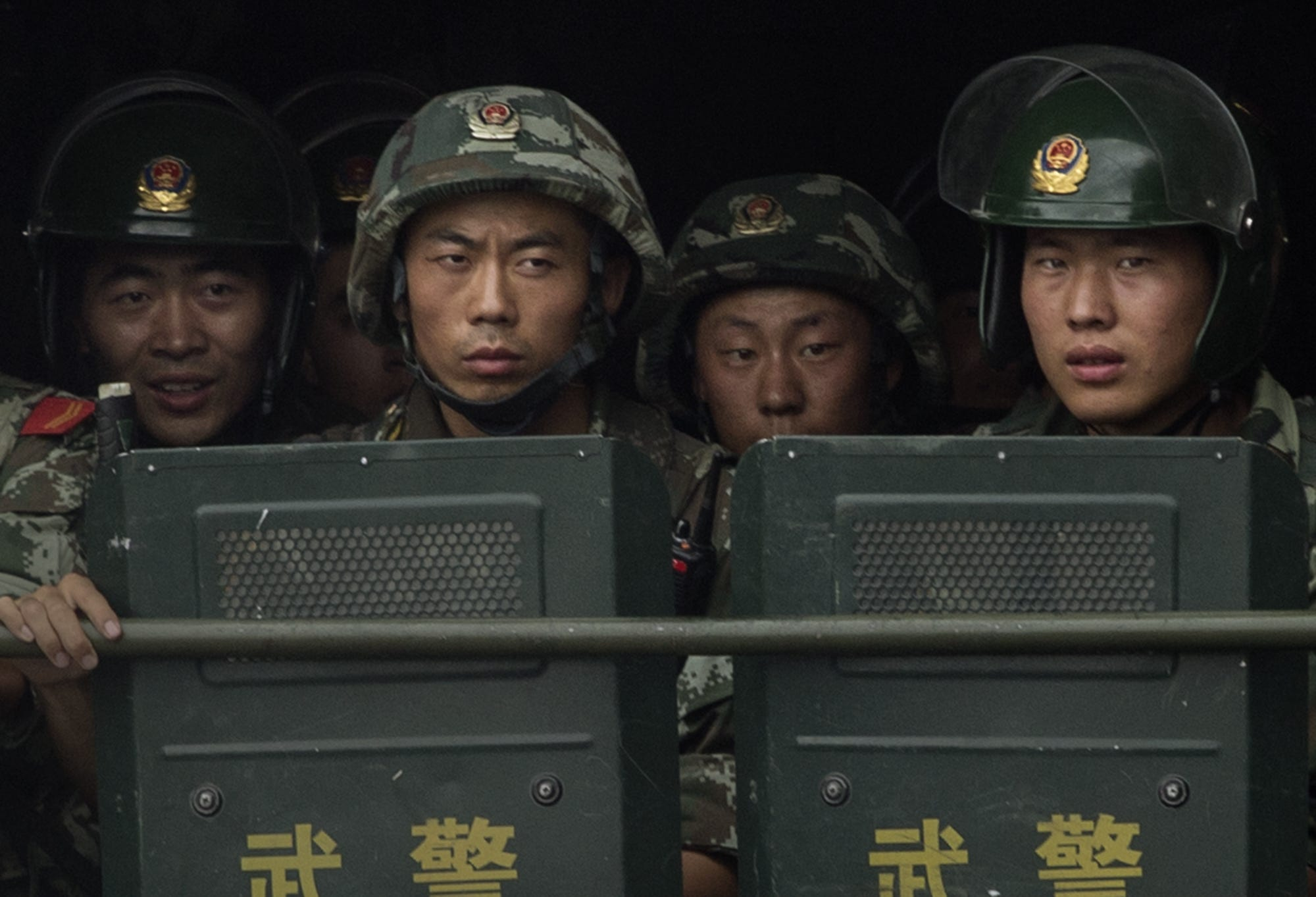 Chinese soldiers ride on the back of a truck as they patrol outside the Id Kah Mosque, China's largest, on July 31, 2014 in Kashgar, China. China has increased security in many parts of the restive Xinjiang province following some of the worst violence in months in the Uyghur dominated area.