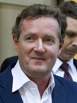 """FILE - In this Dec. 20, 2011 file photo, Piers Morgan, host of CNN's """"Piers Morgan Tonight,"""" leaves the CNN building in Los Angeles."""