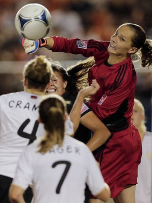 German goalkeeper Laura Benkarth, right, and the USA's Katie Stengel, second from right, battle for the ball during the final match of the under-20 women's World Cup in Tokyo.