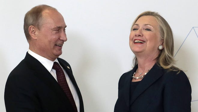 Russian President Vladimir Putin, left, meets U.S. Secretary of State Hillary Rodham Clinton on her arrival at the APEC summit in Vladivostok, Russia, on Saturday.