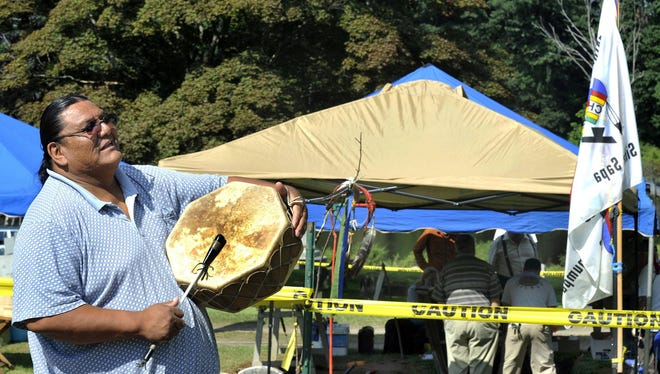Richard Red Elk beats a drum during a ceremony near the grave of Albert Afraid of Hawk in Wooster Cemetery, in Danbury, Conn., on Aug. 16.