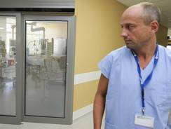 Doctor Petr Bilina stands in front of the resuscitation unit where a 65-old-year man poisoned by methanol alcohol is being treated in the hospital of the Czech town of Pribram.