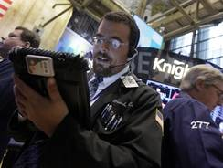 Trader Richard Scardino, center, works on the floor of the New York Stock Exchange in September 2012.