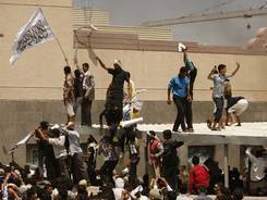 Yemenis protest in front of the U.S. embassy about a film ridiculing Islam's Prophet Muhammad, in Sanaa, Yemen, on Thursday.