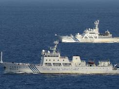 The Chinese surveillance ship Haijian No. 51, front, sails ahead of a Japan Coast Guard vessel in waters near disputed islands, called Senkaku in Japan and Diaoyu by China, in the East China Sea on Friday.