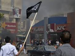 Lebanese protesters attack American fast food restaurants after Friday prayers, pouring petrol on the restaurants and setting them on fire in the northeastern city of Tripoli.