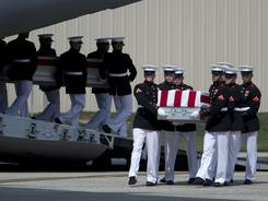 Carry teams transfer cases of the remains of the four Americans killed this week in Benghazi, Libya, at Andrews Air Force Base, Md.