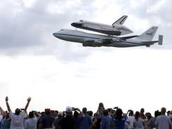 Space shuttle Endeavour flies over Ellington Field in Houston atop a shuttle aircraft carrier Wednesday.